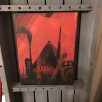 Spray paint painting of a triangular machine with teeth